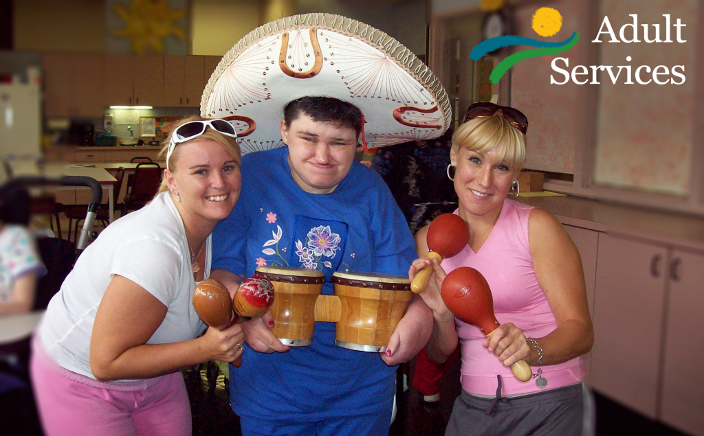Adult Day Services. Photo of workers and consumer with musical instruments.