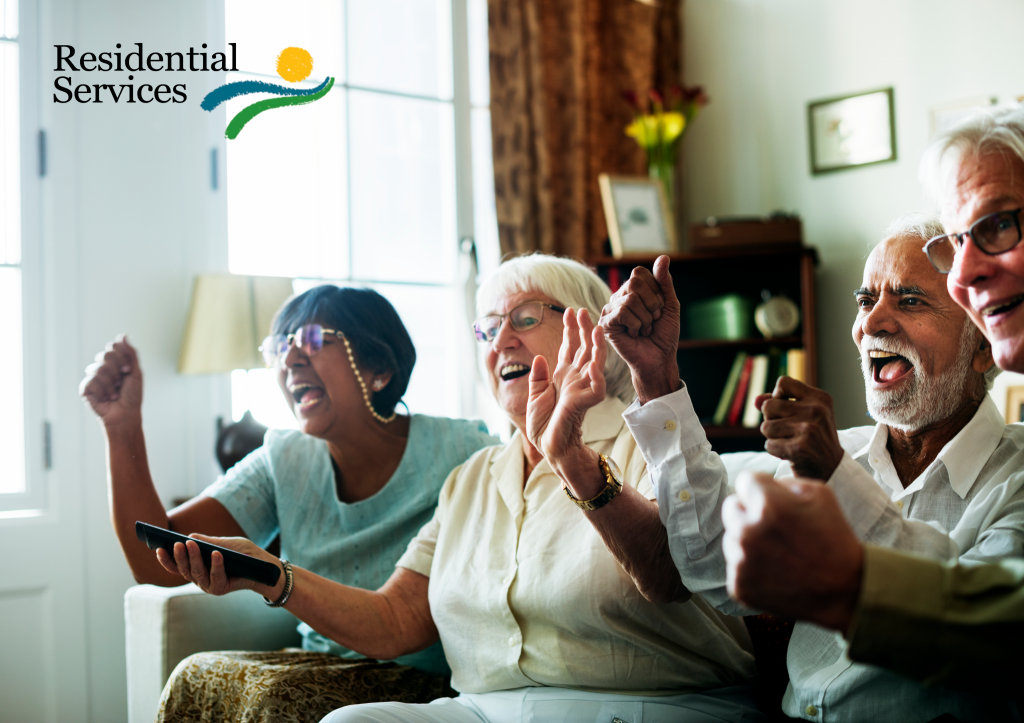 Residential Services. Photo features happy elderly people together on a couch watching TV. Courtesy of rawpixel.com / Freepik.